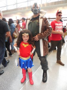 Father and daughter as Bane and Wonder Woman at New York Comic Con 2014